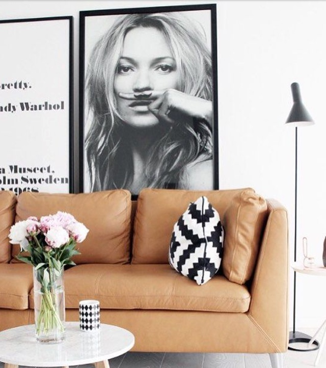 tan couch, black and white pillows
