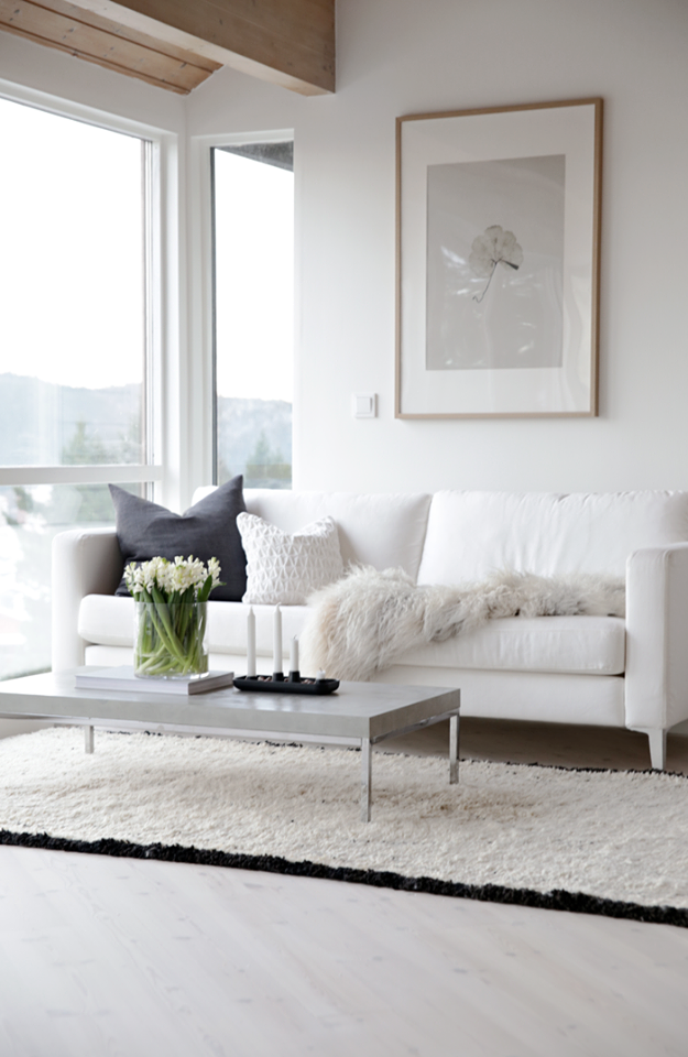 white couch with black pillow minimal chic