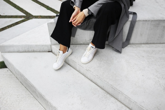 white sneakers black pants