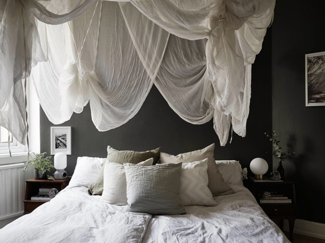 gauze hanging over bed