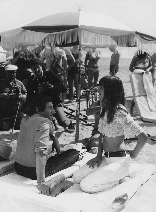 Cannes in 1969, Jane Birkin wears a lace crop top with white jeans.